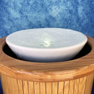 Gushing Spring water effect, creating clear boil of water in center of baptismal viewed from side.